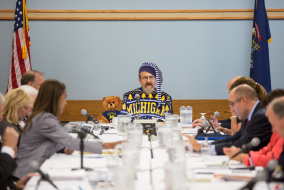 Schlissel at regents meeting dressed in UofM style pajamas