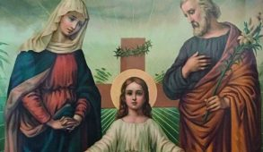 Image of a white Jesus on the cross and two overlookers