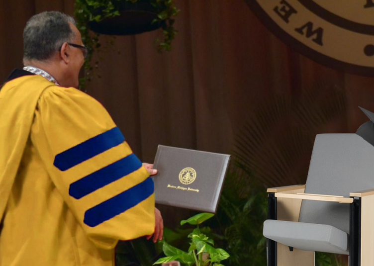 A university official awarding a Ph.D. to a lecture hall seat.