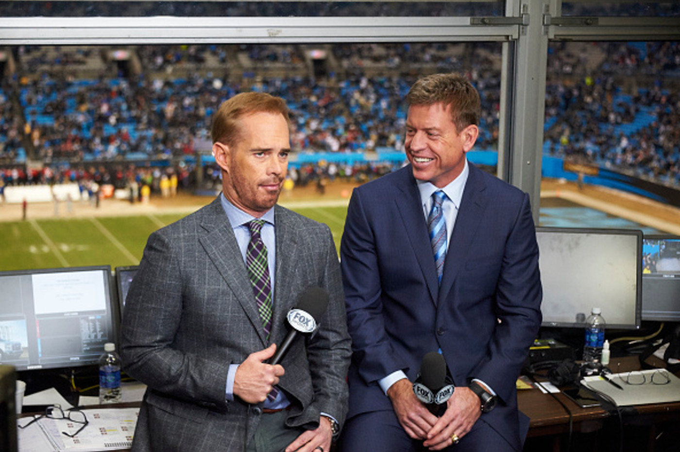 To sports announcer, one looking very excited and one looking more impartial
