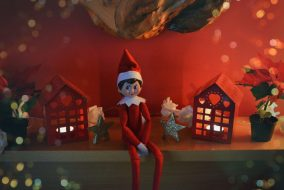 Elf toy sitting on mantel