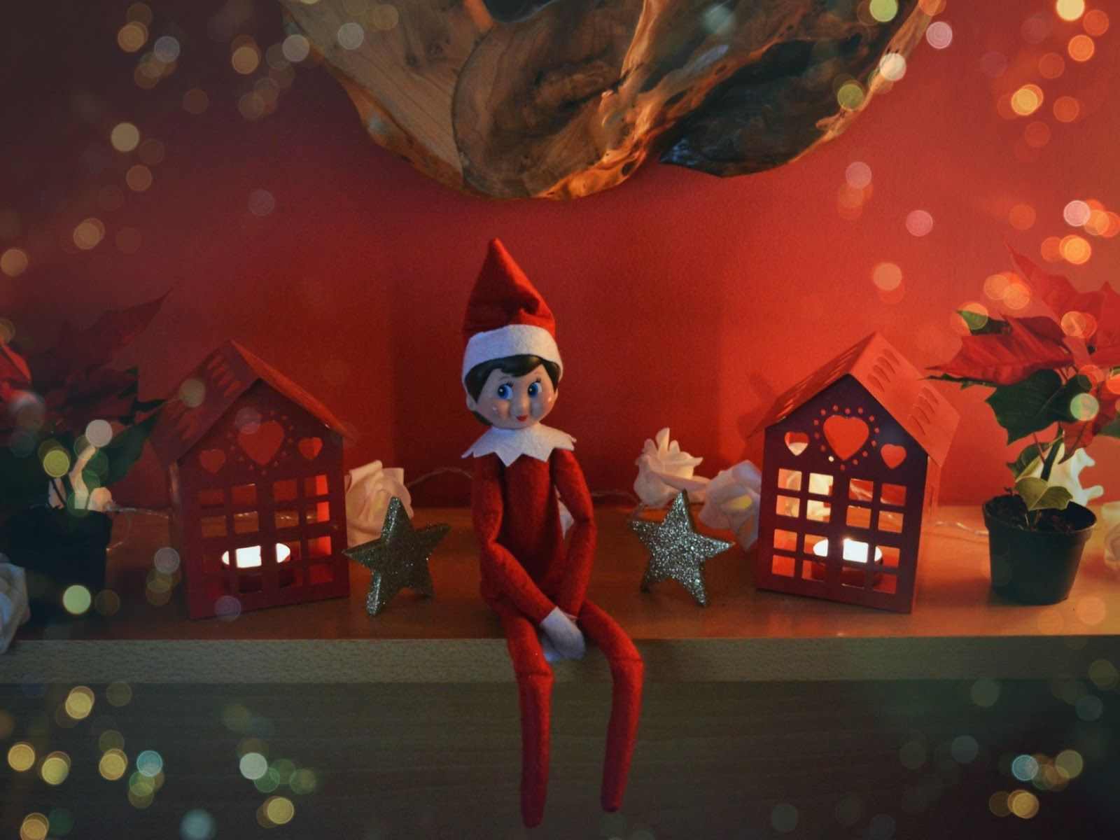 Elf toy sitting on mantel