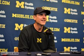 Jim Harbaugh at a press conference