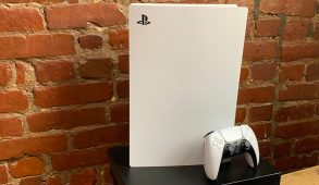ps5 gaming console in front of a brick wall