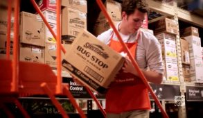 Male Home Depot employee organizing boxes