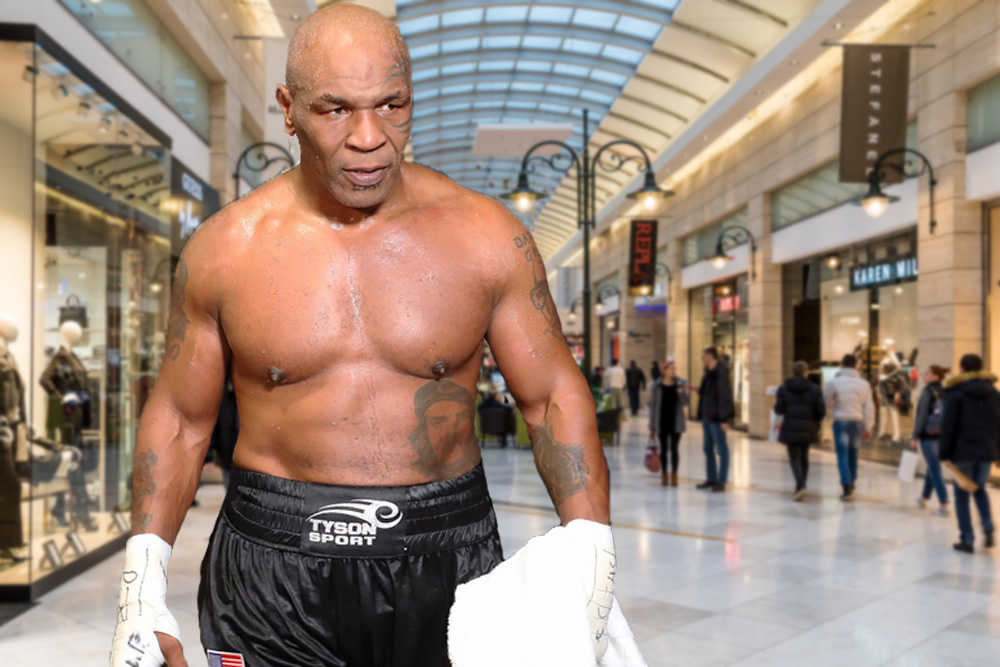 Mike Tyson, shirtless, standing menacingly in a mall