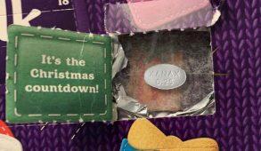 An advent calendar with a Xanax pill inside of it