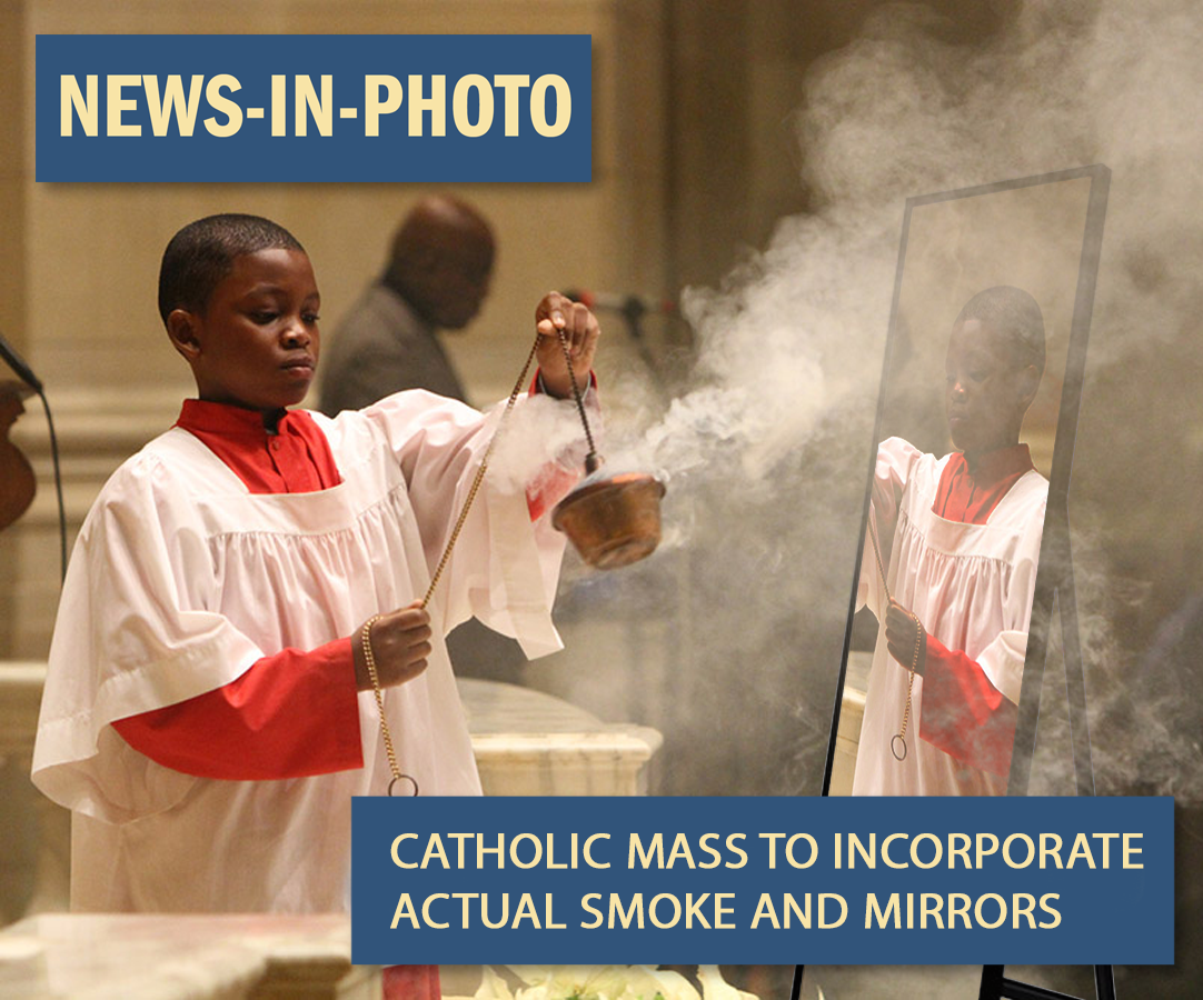 A child dressed in a robe holding a smoking object in front of a mirror.