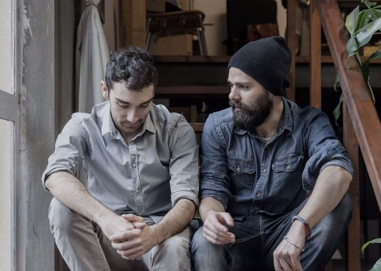 Two stoner men having a conversation.
