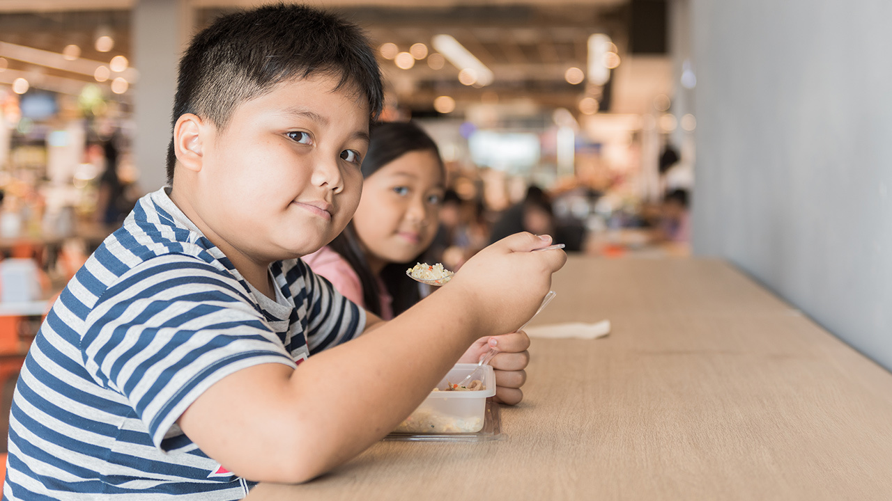 Children sitting at lunch table