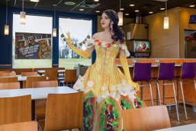 Belle from 'Beauty And The Beast' stands in a Taco Bell.