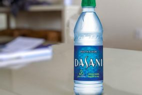"A Dasani water bottle with the title ""mouth-flavored"""