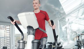 A man on an elliptical machine.