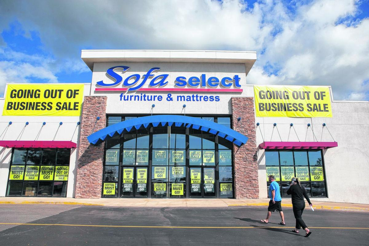 """A store with a """"Going Out of Business Sale"""" sign on it."""