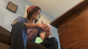Man sitting contemplatively on couch