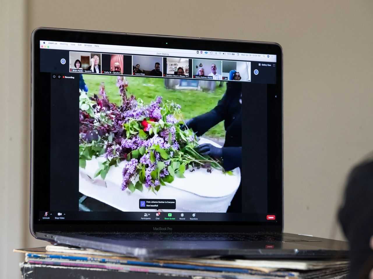 A laptop streaming a funeral over Zoom.