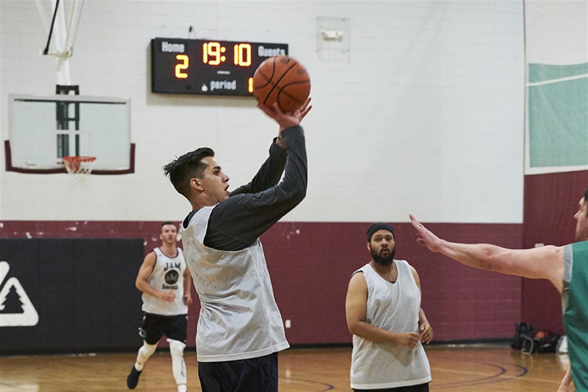 Male basketball player shooting basket