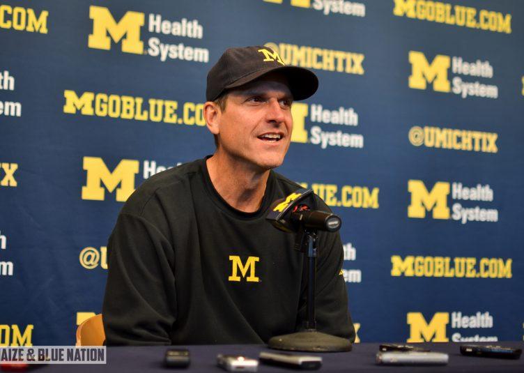 Jim Harbaugh at a press conference