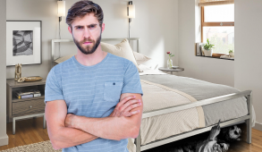 a demon crawling our under the bed, a man stands disgruntled with a blue tshirt