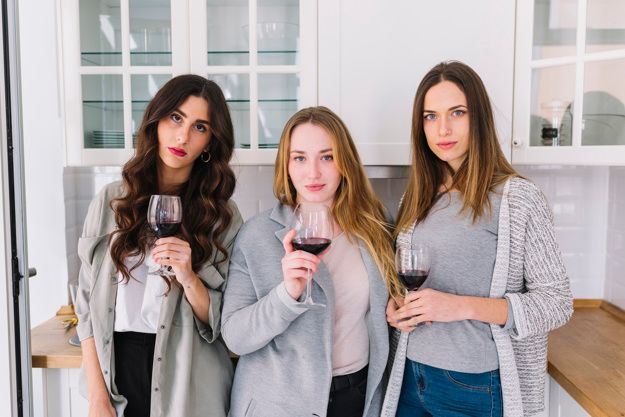 Three women holding wine glasses