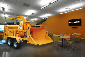 Woodchipper photoshopped inside of corporate lounge