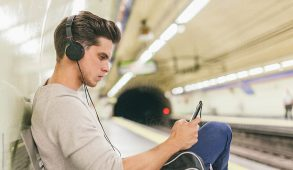 Man with headphones sitting on bench