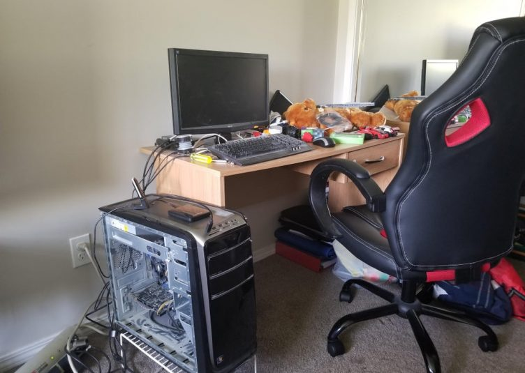 An expensive gaming chair at an unseemly messy desk