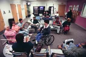 A busy and crowded doctor's office full of patients