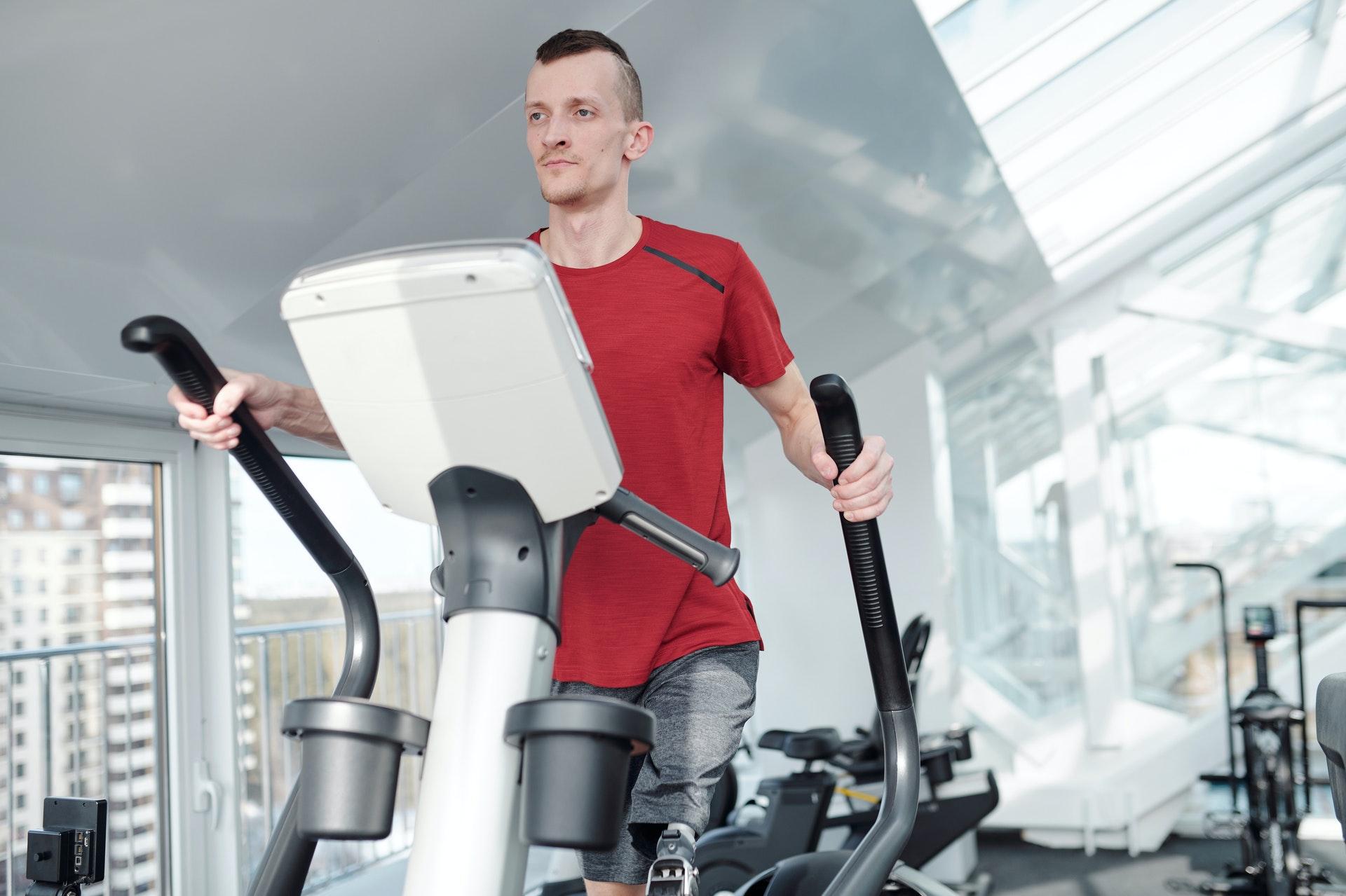 A man on an elliptical machine.