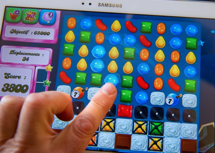 An elderly woman on a difficult Candy Crush level