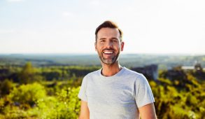 A happy-looking man outside.