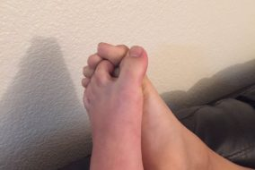 Two feet with toes locked together